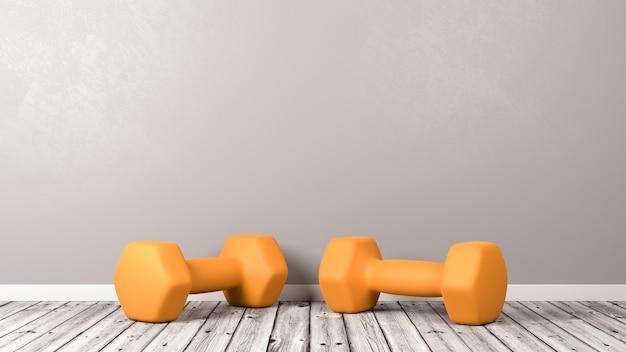 Orange dumbbells on wooden floor in the room