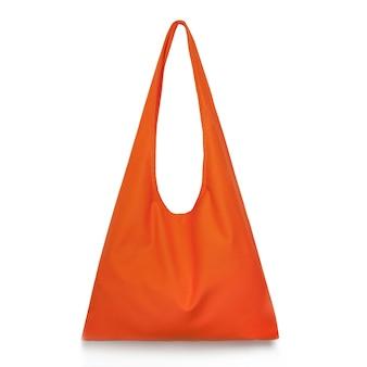 디자인을위한 흰색 격리 된 표면 장소에 오렌지 패브릭 쇼핑 가방 생태학 또는 환경 보호 개념 모형 빈 템플릿에 대한 캔버스 패브릭
