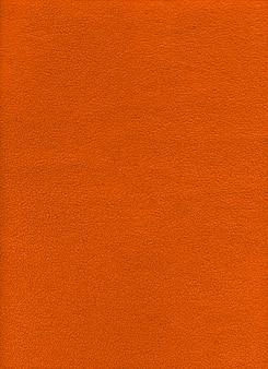 オレンジ色のフリースの背景のテクスチャです。クローズアップビュー