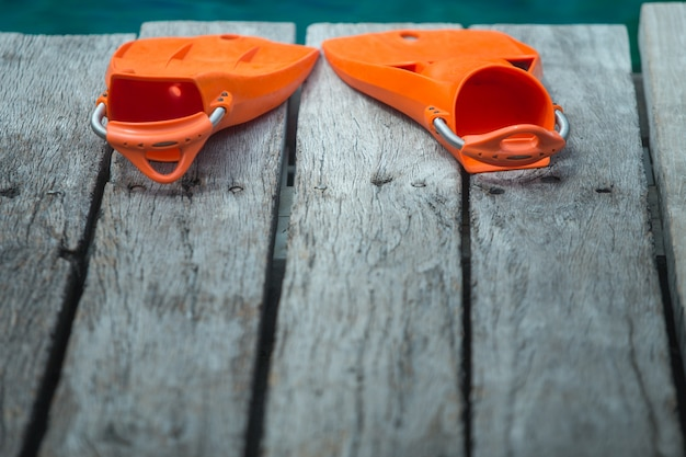 Orange flippers for diving