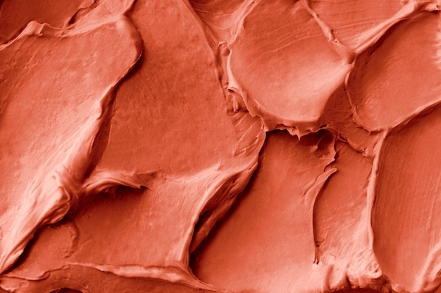 Orange frosting texture background close-up