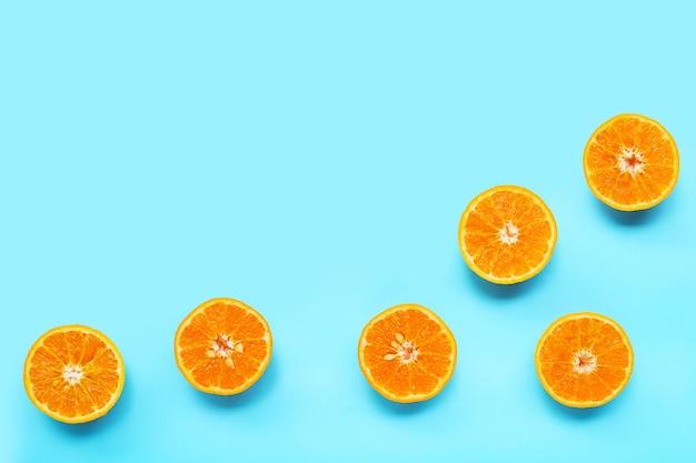 Orange fruit on blue background.  copy space