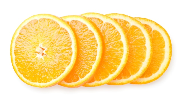 Orange fruit cut into circles on a white background. the view of the top.