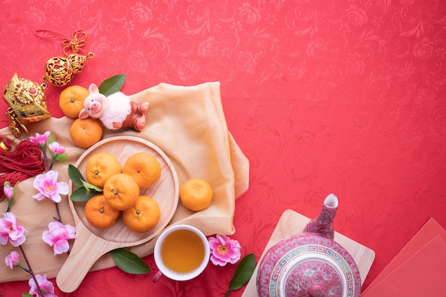 Orange fruit, pink cherry blossom and teapot