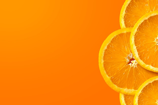 Orange fruit on yellow and red background