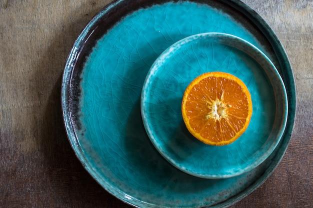 Orange fruits on turquoise plate
