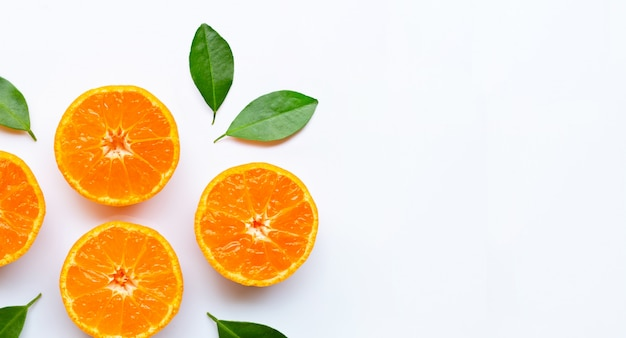 Orange fruits with  leaves on white background.