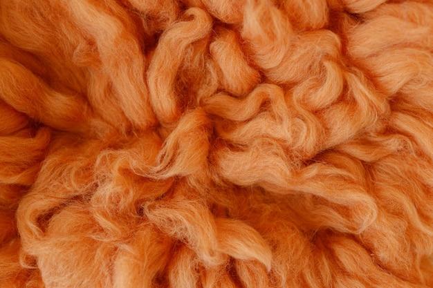 オレンジ色の毛皮のテクスチャ背景