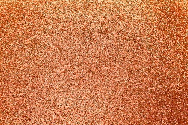 Оранжевый блеск блестящей текстуры фона