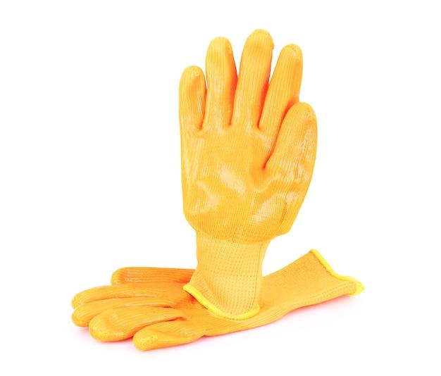 白い背景の上のオレンジ色の手袋