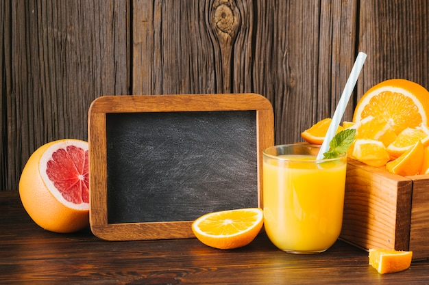 Orange and grapefruit juice with copy space