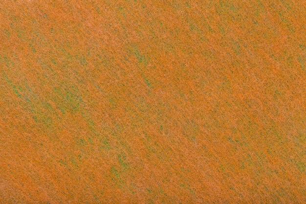 Orange and green background of felt fabric