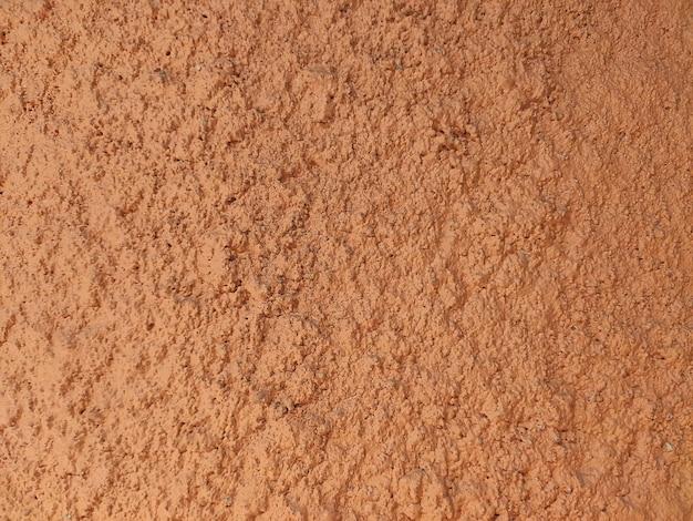オレンジ色のグランジレイヤード壁の背景