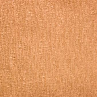 背景のためのオレンジの手作りの紙のテクスチャ