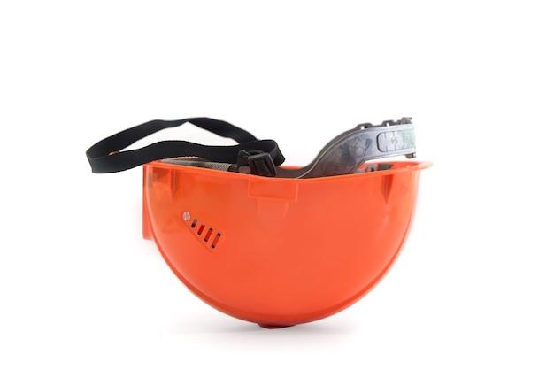 白い背景で隔離のオレンジ色のハード帽子