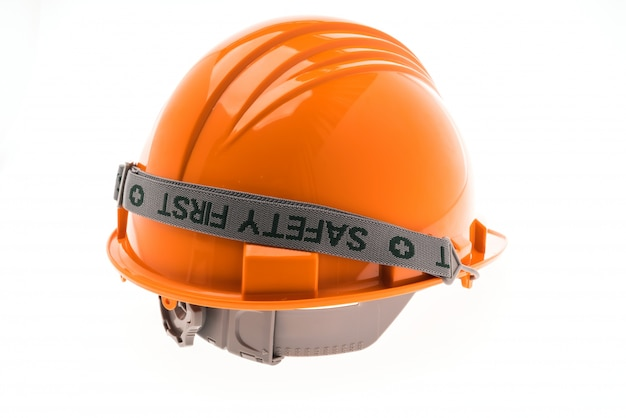 Orange hard plastic construction helmet on white background .