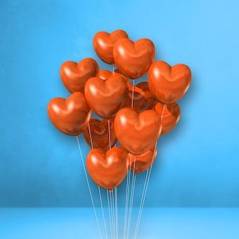 青い壁の背景にオレンジ色のハート型の風船の束。 3dイラストレンダリング