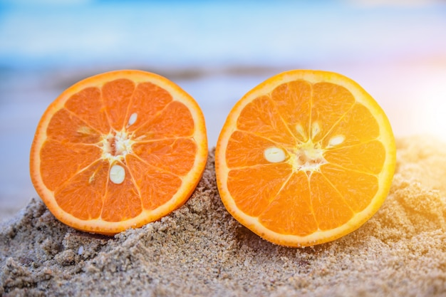 Orange is on beach sea view background,summer holiday concept