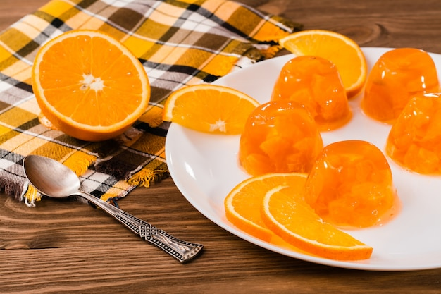 Orange jelly and orange slices on a plate