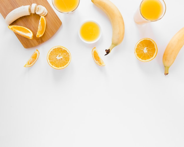 Orange juice and bananas with copy space
