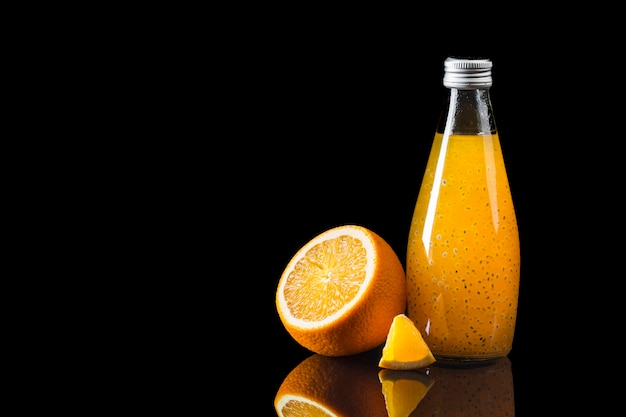 Orange juice on black background