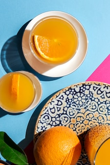 Orange juice from above on colored walls.