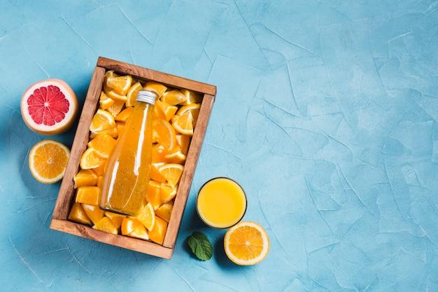 Orange juice and grapefruit with copyspace