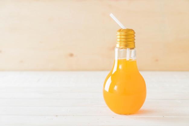 Orange juice in lamp shape glass Free Photo
