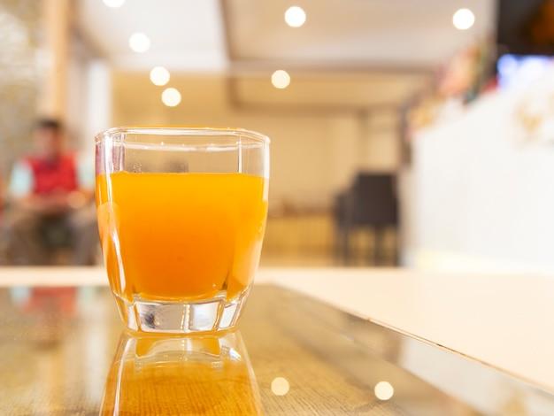 Orange juice in living room hotel.