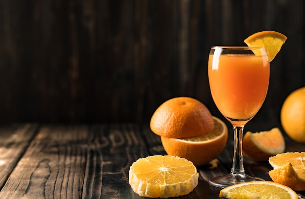 Orange juice mandarin orange on  wood,copy space