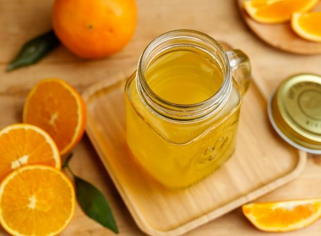 Orange juice and oranges on retro wooden desk