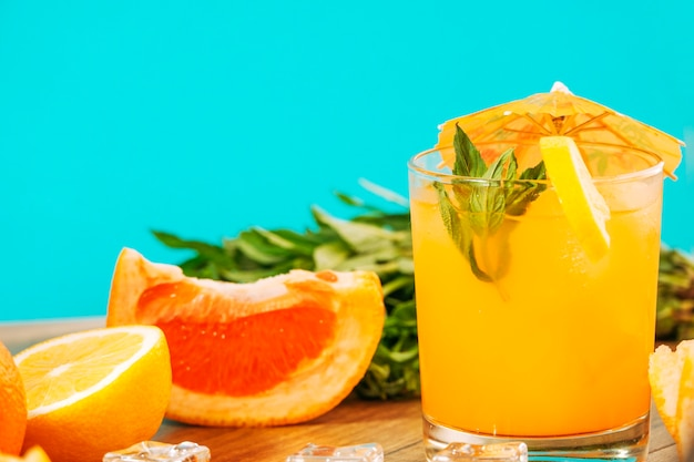 Orange juice and pieces of citrus fruits
