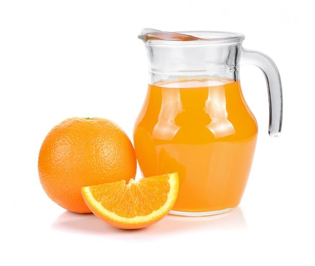 Orange juice in pitcher and oranges. isolated