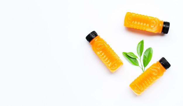 Orange juice in plastic bottles on white background.