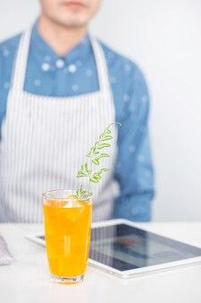 Orange juice soda mix on marble tile background.