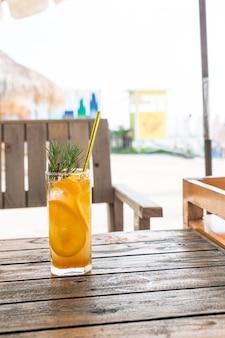 Orange juice soda with rosemary in cafe restaurant