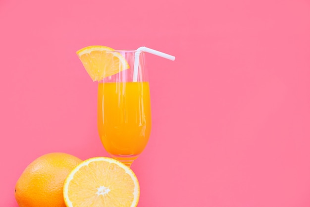 Orange juice summer glass with piece orange fruit