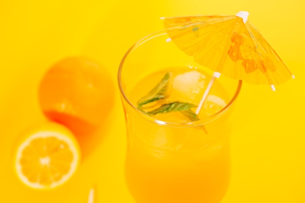 Orange juice with peppermint in hurricane glass