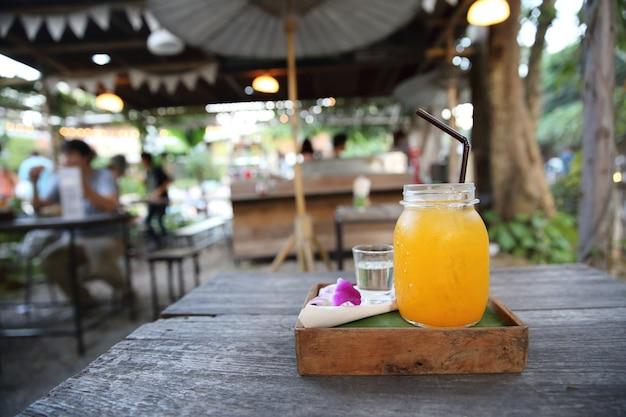 Orange juice on wood background