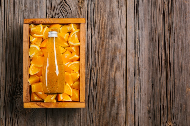 Orange juice on wooden background copyspace