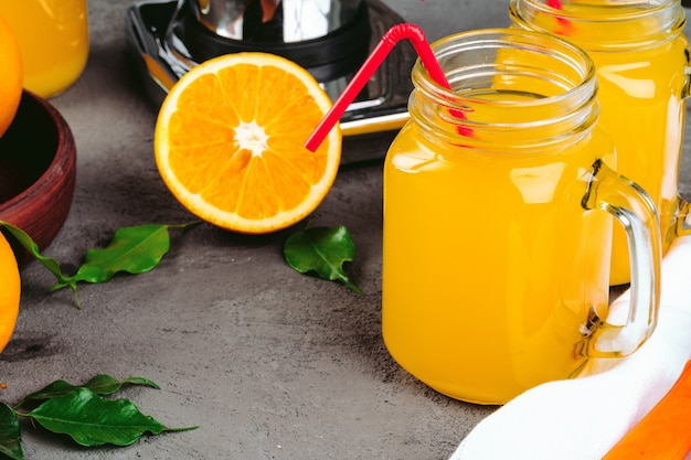 Orange juicer apparatus on kitchen table close up