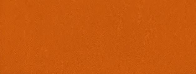 オレンジ色の革のテクスチャ背景。