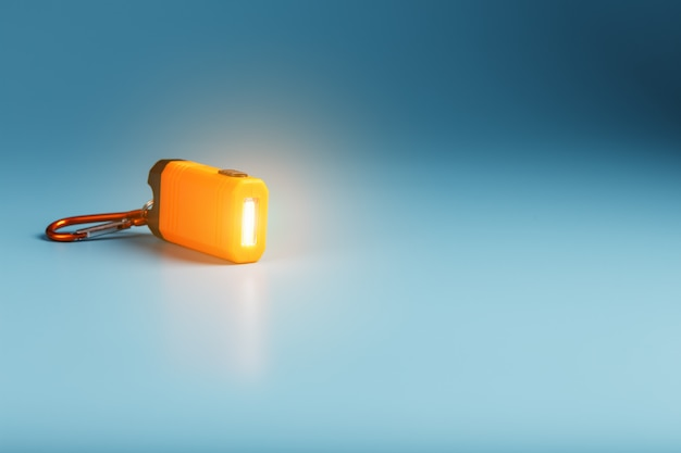 Orange led flashlight with a carabiner