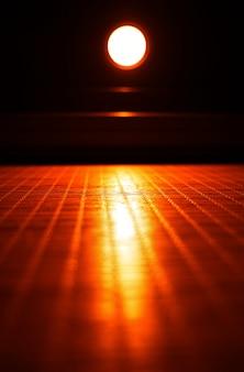 Orange led lamp illuminating neon surface background