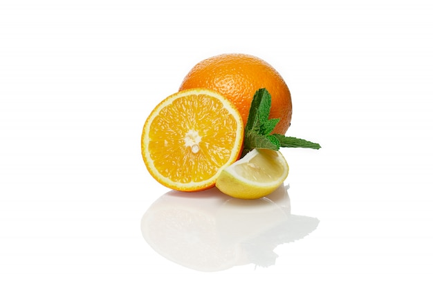 Orange, lemon and mint isolated on white