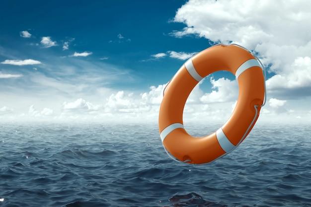 물에 오렌지 lifebuoy입니다. 도움, 구조, 익사, 폭풍의 개념. 공간을 복사하십시오.