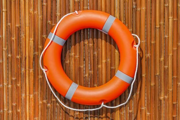 Orange lifebuoy pool ring float.