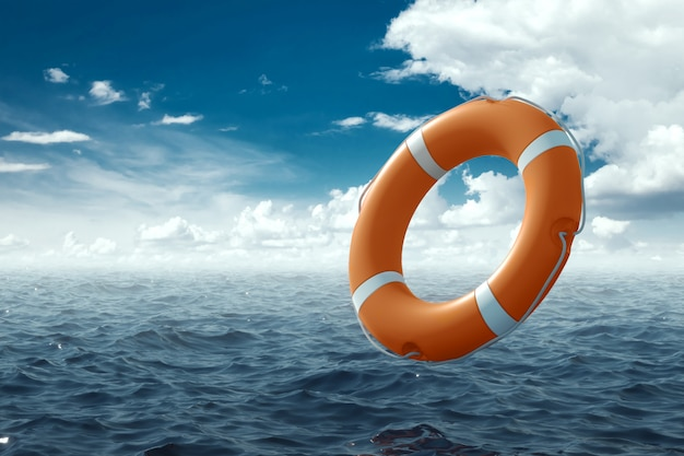 Orange lifebuoy on the water. the concept of help, rescue, drowning, storm. copy space.