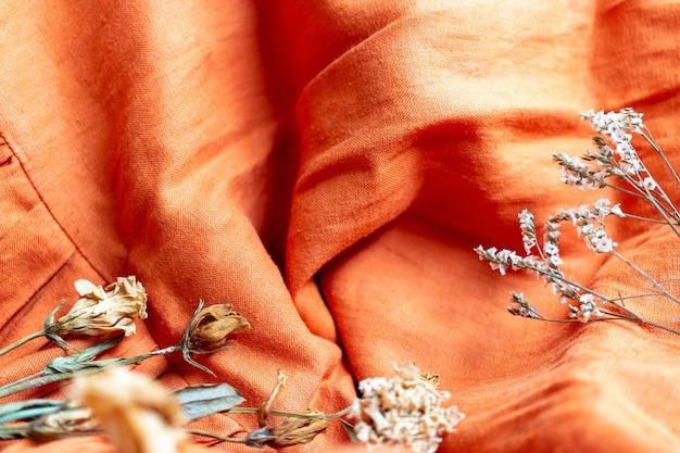 Orange linen fabric texture background , autumn beginning backdrops