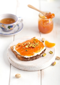 Orange or mandarin jam on a white background